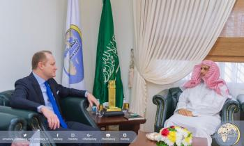 HE the SG meeting Mr. John Godfrey, Director of the political section of the US Embassy and his accompanying delegation in Riyad.